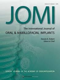 Int J Oral Maxillofac Implants